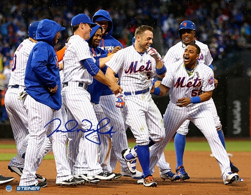 NEW YORK, NY - MAY 21: David Wright #5 of the New York Mets is congratulated by Yoenis Cespedes #52 and the rest of his teammates after Wright hit a walk off single to win the game over the Milwaukee Brewers at Citi Field on May 21, 2016 in the Flushing neighborhood of the Queens borough of New York City.The New York Mets defeated the Milwaukee Brewers 5-4. (Photo by Elsa/Getty Images)